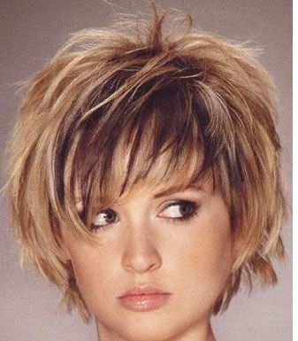 Young women hairstyle with full of layers and highlights with long bangs.PNG
