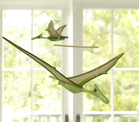 Dinosaur moving mobiles from Pottery Barn Kids. A more aspiring do-it-yourselfer could make these for a fraction of the price. Me? I bought 'em.