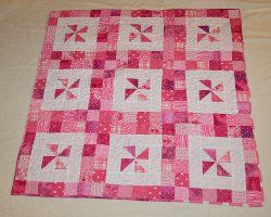 Pinwheel quilt patterns are a fun way to use half square triangles to add an easy, cheerful design to your next spring quilt. Come see our list of 17 ways you can make new quilts with free pinwheel quilt patterns.