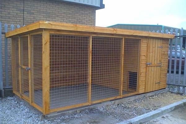 DIY Outdoor Dog Kennel A backyard DIY dog kennel is perfect if you work long hours and dont like leaving…