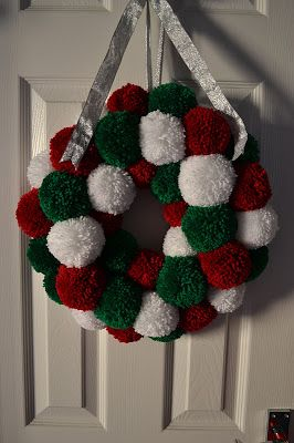 In my last post I mentioned how much in love I am with my Clover pom pom maker and that I had an idea for a wreath. Well, it's finished now ...