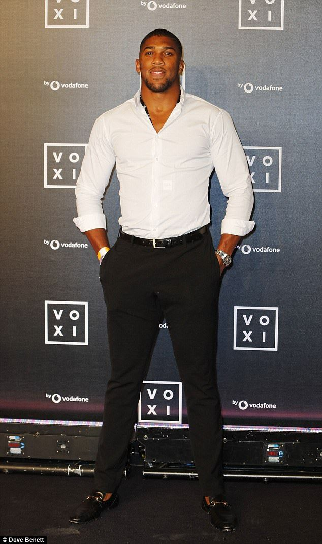 Good looking: Boxer Anthony Joshua put his feud with Amir Khan behind him as she put on a handsome display at the event