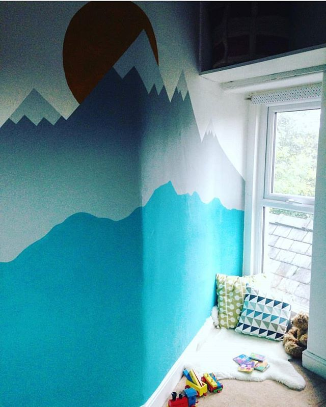 Day 24 of #myhousethismonth is WALL ART. Heres a mural I painted in my little boys room when I was preggers - hes nearly 2 already!? I toyed with the idea of painting the lower, rolling hills section with chalkboard paint. The though of all that dust in his bedroom put me off a bit though 🤧. . Hope youre all having lovely weekends! Im currently waiting for mr woollysaurus to come back with curry... 😁🤗 . . . . #myspringrevamp #dailydecordetail #mydiymydecor #diy #wallart #painting #art…