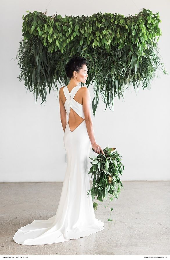 Bride in open back wedding dress with foraged greenery | Photography by Wesley Vorster |  http://www.theprettyblog.com/wedding/eco-chic-inspiration/