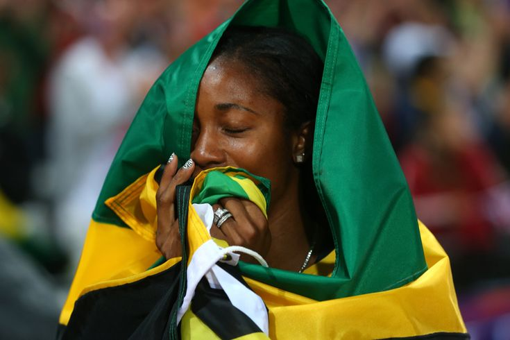 Shelly-Ann Fraser-Pryce of Jamaica celebrates winning the gold in the women's 100-meter final on Aug. 4 at the Olympic Stadium. (Alexander Hassenstein/Getty Images) #