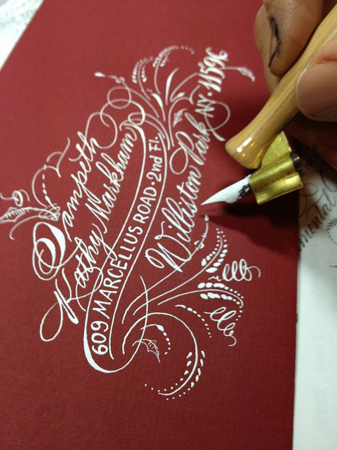 White ink, hand lettered envelope with gorgeous lettering.