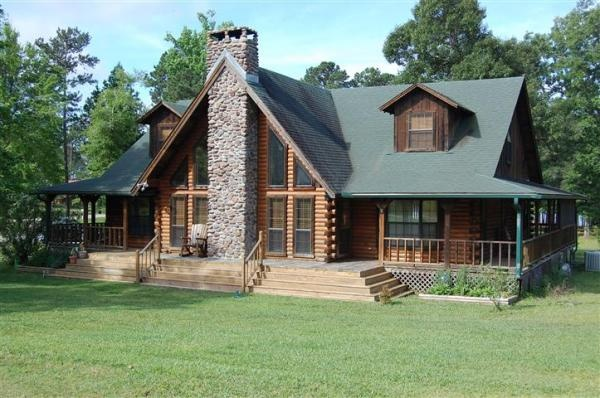 Motivated seller lakefront log home in texas spacious for Log home plans texas