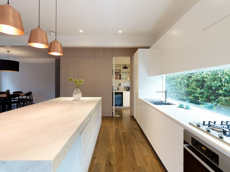 splashback cupboards above. copper lights pantry doors