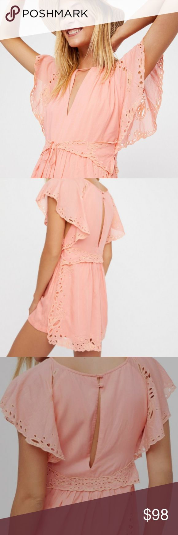 NWT Free People Sahara Romper in Peach Sold out super flirty and adorable femme lightweight romper featuring a tonal overlay with eyelet trim. I ordered this off the Free People website and the tag was ripped in half when I got it in case anyone's wondering. Never worn! :) Reasonable offers welcomed!   V-neckline Flutter sleeves Adjustable tie front Slit detailing in back with button closures Hidden side zip closure Free People Pants Jumpsuits & Rompers