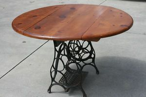 Pine drop-leaf table made with antique treadle sewing machine base