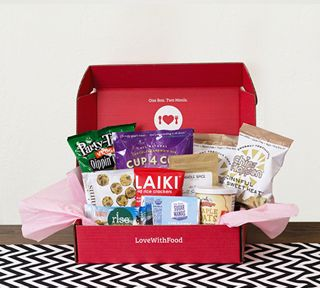 Love of Food monthly subscription box of surprise snacks. Each box donates a meal to those in need. They have a Gluten free box too!