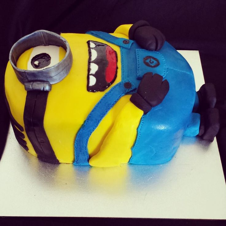 My first Minion Cake!!  The equivalent to 6 of my cake mixtures (each mix makes 12 cupcakes) Two layers covered with ganache and fondant.