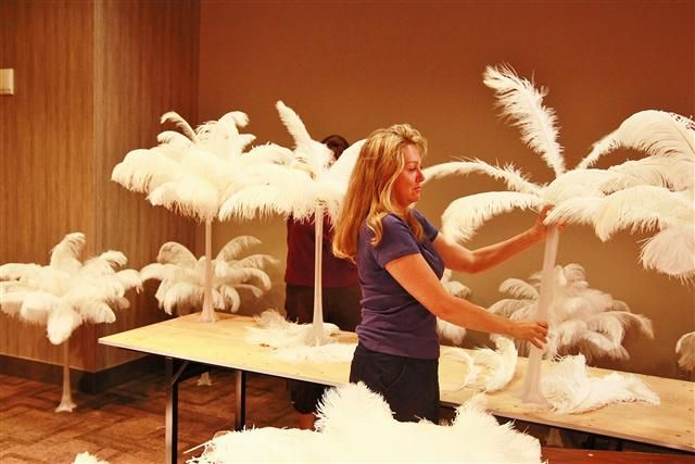 DIY ostrich feather centerpieces- with sourcing info.  Frosting spray for clear eiffels. 24""