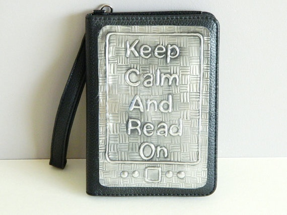 Keep Calm and Read On Kindle Cover for Fathers Day. SUPERB QUALITY GENUINE LEATHER BLACK CASE FOR AMAZON KINDLE 4 with a built-in reading lamp and hand strap.     This Kindle case is a perfect fit for the Kindle 4. The reading lamp folds away into a secure pocket out of the way. The strap handle is great for carrying your Kindle with you wherever you go.   Batteries are included