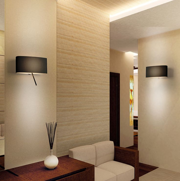 PUPILLAdesigner: Massimo Mussapi Wall lamps with integrated adjustablereading light. Opal methacrylate diffusercoated with composite fabric fireproofblack or pearl grey. Ambiance lighting is grantedby a LED plate for main supply 220-240V,whereas personal reading light is supplied bya power LED with converter on board.