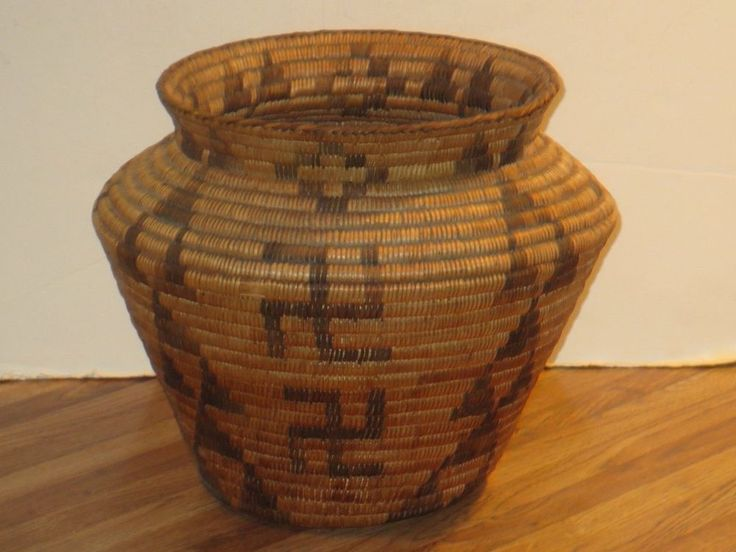 (Mid-late 1800's). Featuring a whirling log or swastika and arrow design encompassing the entire surface. The basket is pictured in the round and is in excellent condition for its age. It has no separations or repairs.   eBay!