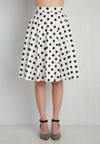 You hear your friend's truck horn outside your window - your trumpet call to dance this A-line skirt out the door and hop in! Boasting a high waistline, this bright white and black bottom - with its cottony fabric and cute black button - look blissful against every panorama you pass.