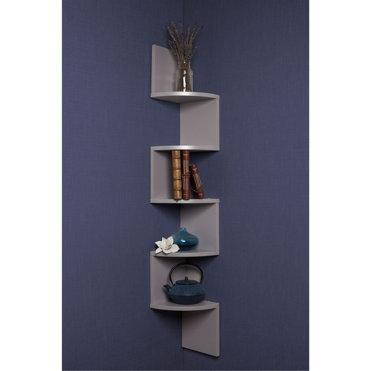 Danya B™ Grey Laminate Corner Shelf makes space utilization possible from any corner. Creative design and space saving solution for small areas. With its contemporary grey finish, it is the ideal accent for any living space. Mounting hardware included.