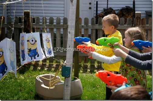 Despicable Me Birthday Party - Game:  print out and laminate pictures of minions – 1 per kid.  El Macho (Daddy) came by and made all the Minions evil by painting them with watery purple paint. The kids than used their water guns to return their minion to normal.