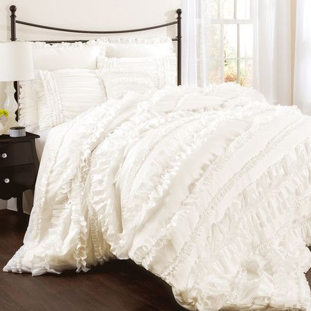 Ruffled comforter set in ivory. Product: Queen: 1 Comforter, 1 bedskirt and 2 standard shamsKing: 1 Comforter, ...