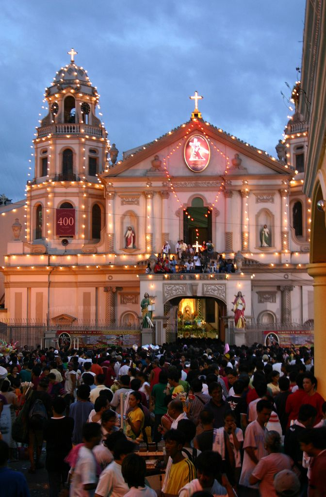 MANILA - FILIPINAS -festive Quiapo | lights adorn the Quiapo Church as thousands wait for the return of the Black Nazarene from a procession. The carriage carrying the image left the church Jan 8 and was displayed overnight at the Quirino Grandstand in Manila. The return commemorates the first procession to transfer the Black Nazarene from a church in Intramuros to the Minor Basilica in Quiapo on Jan. 9, 1767. Feast of the Black Nazarene Quiapo, Manila Philippines