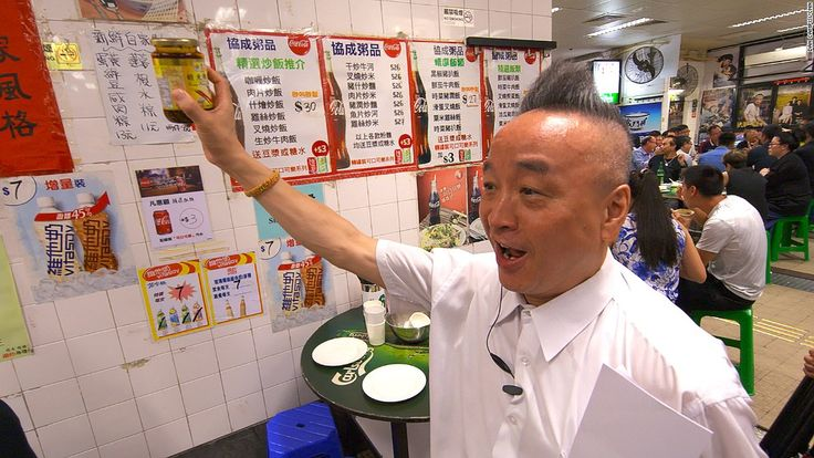 The owner of Tung Po restaurant in Hong Kong puts on a show, whether he's opening bottles with chopsticks or doing the splits on the floor.