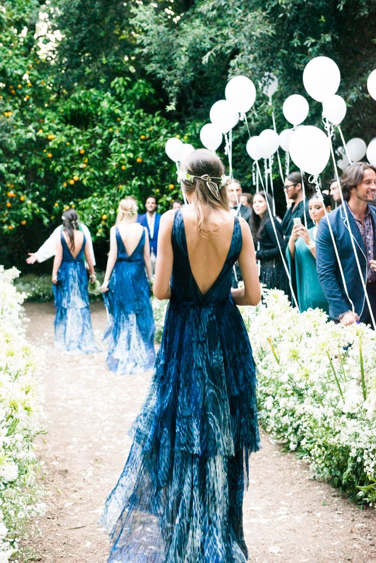 A peacock inspired bridesmaid dress for an outdoor zoo inspired wedding.