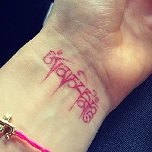 "ellie-goulding-tibetan-wrist-tattoo- Tibetan mantra ""Om mani padme hum"" which means ""jewel in the lotus."""