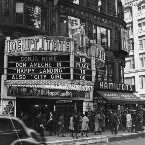 """Happy Landing"": The crowded sidewalk beneath the Loew's State Theater marquee, 7th and Broadway in downtown Los Angeles, 1938."