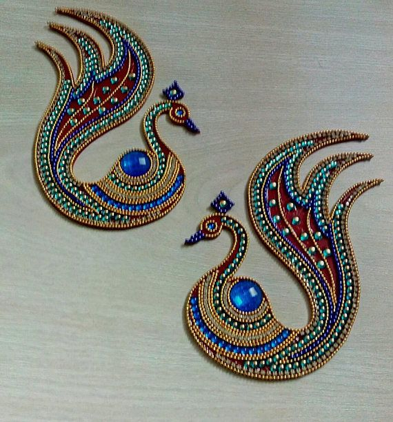 A rangoli is a colourful design made on the floor near the entrance to a house to welcome guests. At Diwali, Hindus draw bright Rangoli patterns to encourage the goddess Lakshmi to enter their homes. -Beautiful one -of-a-kind, Blue Peacock shaped kundan rangoli for wedding and festival