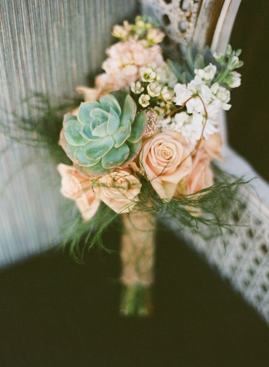 succulents and rose bouquet. This would work with your proposed color scheme, and be unique and pretty. Idk about bouquet, but maybe table pieces or something?