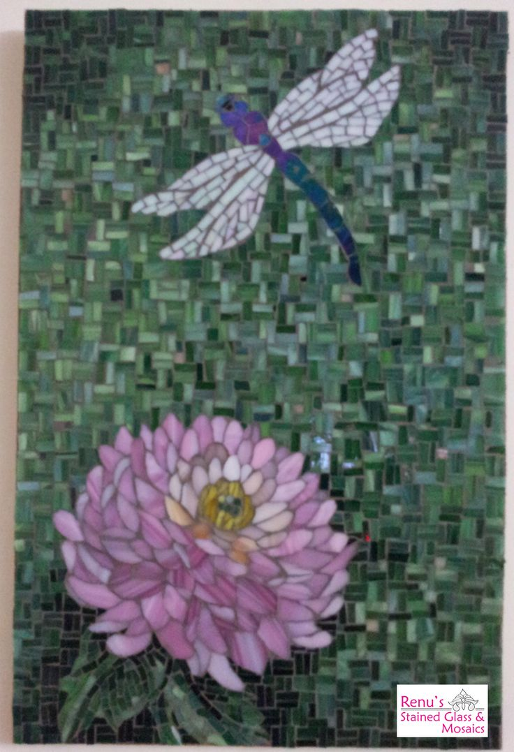 Stained glass mosaic..Dragonfly and flower