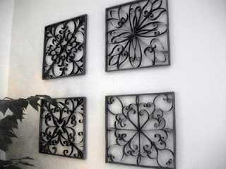 DIY wrought iron wall decor but made from toilet paper rolls. Cool!