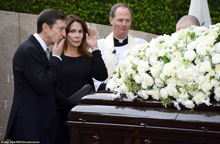 Ronald Reagan Jr blows a kiss to his mother's casket as his sister, Patti Davis, looks on, following Nancy Reagan's funeral