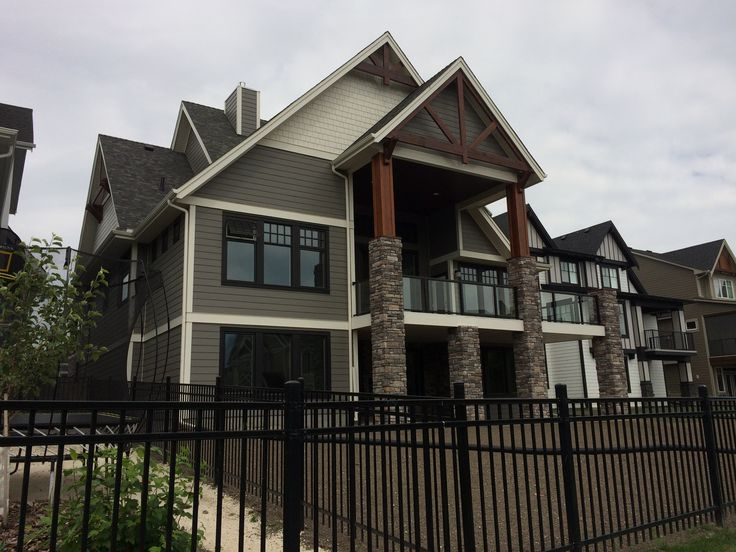 Magnificent two story columns combine natural wood uppers and strong looking rock base #organic material #columns #rear deck #coopersairdrie