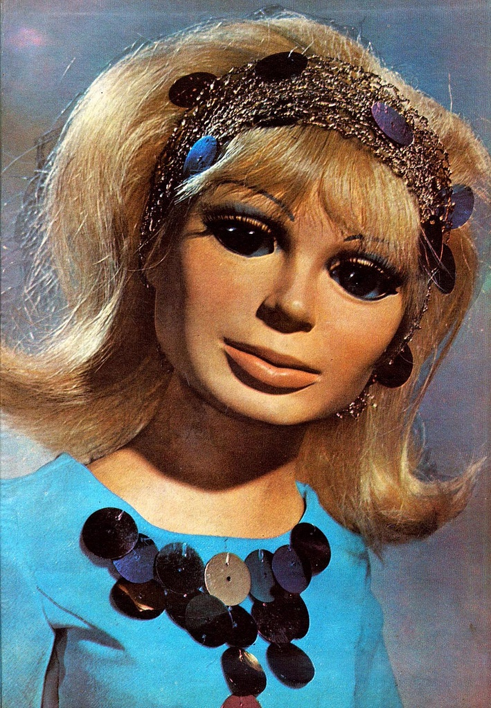 Lady Penelope from Thunderbirds (1964-65)  Loved this show, kinda creeped us out, but still loved it!