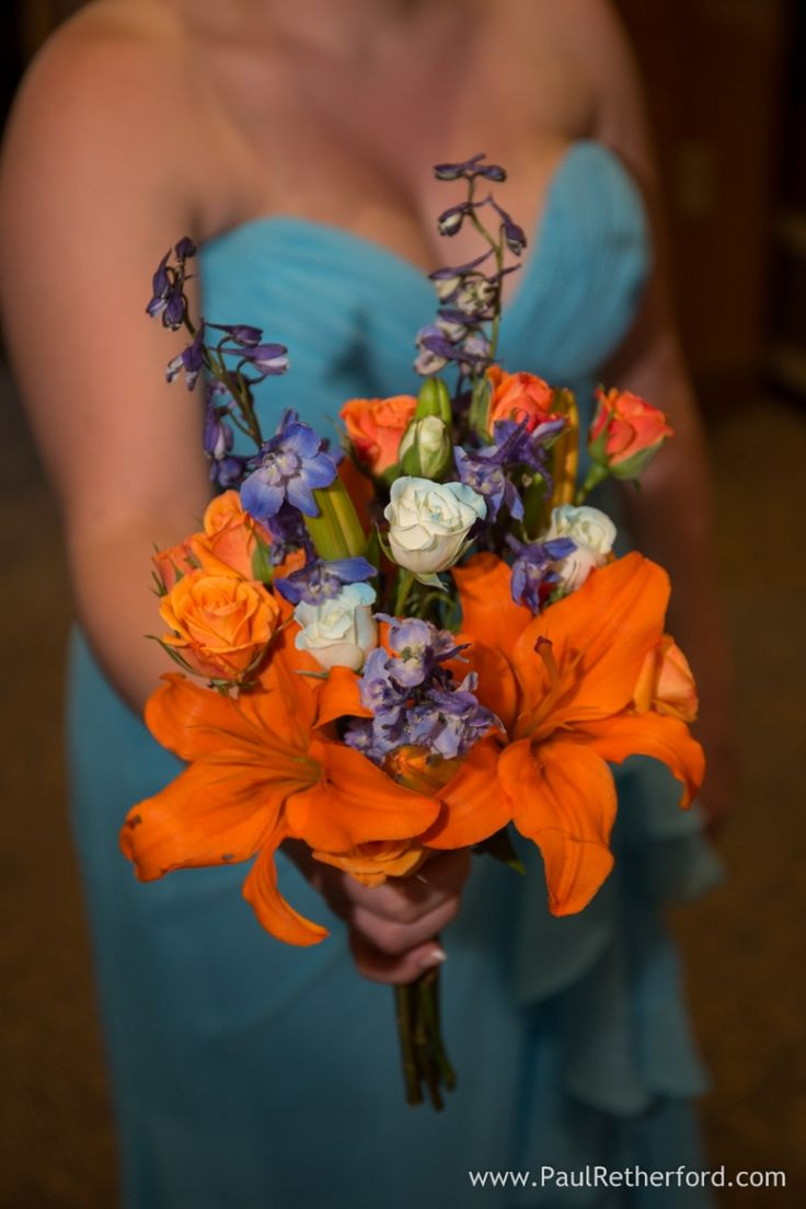 Flowers on the Avenue turquoise orange wedding flower photo by Paul Retherford Photography at The Toledo Zoo Wedding in Northern Ohio #weddingflower #toledozoowedding #zoowedding #orange #turquoise #bouquet #flowers #weddingday #africanthemedwedding