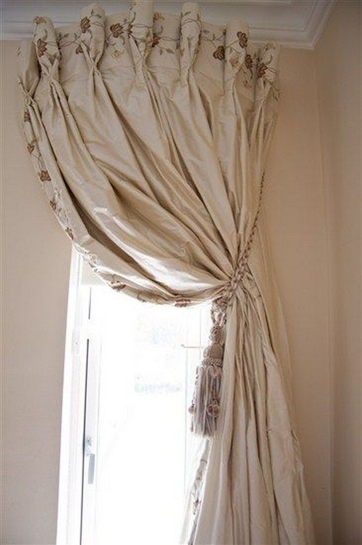 23 Use A Curved Shower Curtain Rod To Make A Window Look Bigger