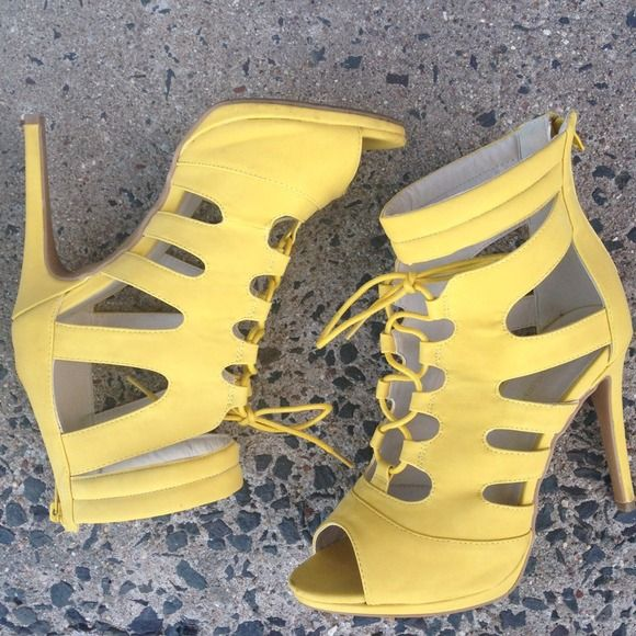Yellow Strappy Heels Trendy! You can pair them with your favorite ripped jeans or daisy dukes for a street look. (Worn once) Shoes Heels