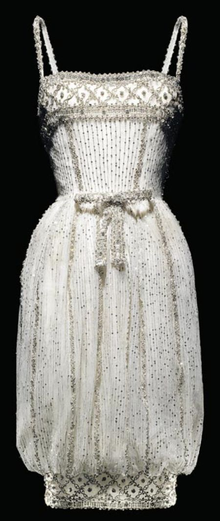 Christian Dior by Yves Saint Laurent - Armide dress, Autumn-Winter 1959-1960 Haute Couture collection. Short evening dress in white tulle with silver sequins.
