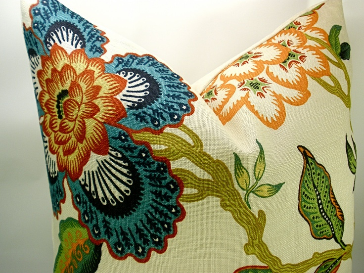 Celerie Kemble print for F. Schumacher features bold and dramatically scaled flowers. It adds a modern twist to a classic floral scheme. The colors featured in Spark are absolutely stunning; the deep orange, scarlet red, teal blue and navy are intense and coordinate with many designer favorite fabrics