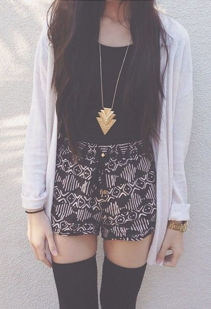 Patterned shorts, thigh high black stockings, white cardigan & tribal necklace