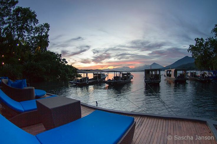 """Vacation used to be a luxury, but in today's world it has become a necessity."" Author Unknown    Here for your next vacation?    Photo by Sascha Janson: Our dive boats at sunset, seen from the ever inviting Lembeh Resort pool deck."