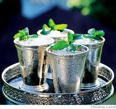 Mint Julep: A traditional southern cocktail made with spearmint leaf, bourbon, sugar, and water, served in a silver cup.