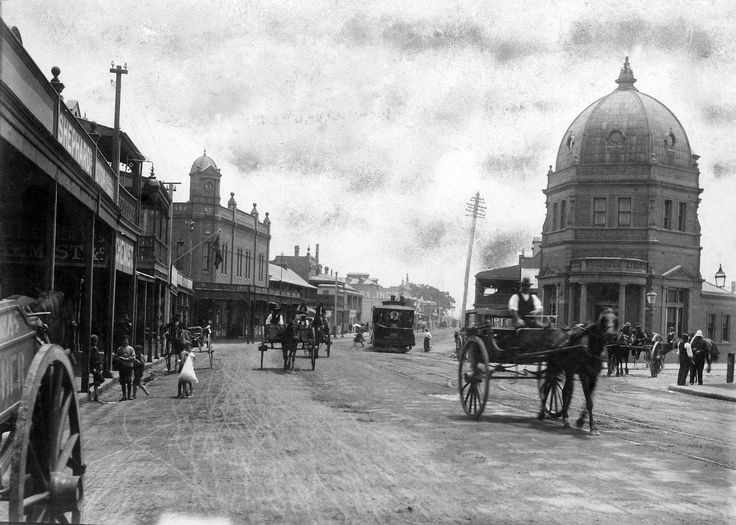 https://flic.kr/p/UwcSTW | Looking west down Hunter Street, Newcastle, near Bank Corner | In 1885, the Australian Joint Bank purchased land at the end of Hunter Street. The building, which cost £4,000 to build, had a dome shaped roof which became a local landmark. Marcus Clarke's department store can be seen centre left. The intersection became locally known as The Bank Corner. Crofts Collection, Newcastle Region Library HPB 006 000106