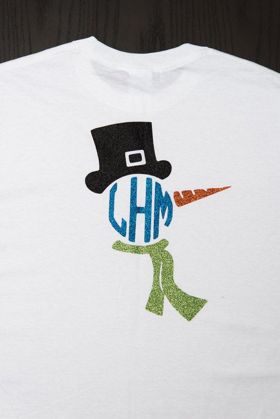 This shirt is so cute for Winter! The Snowman has a black glitter hat, blue glitter monogram, orange glitter nose and green glitter scarf. This