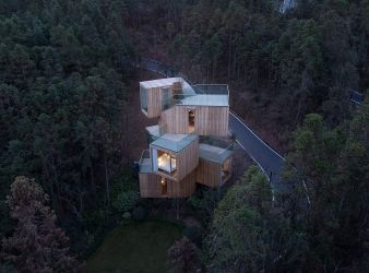 Every room in the house has a panoramic view of the forest