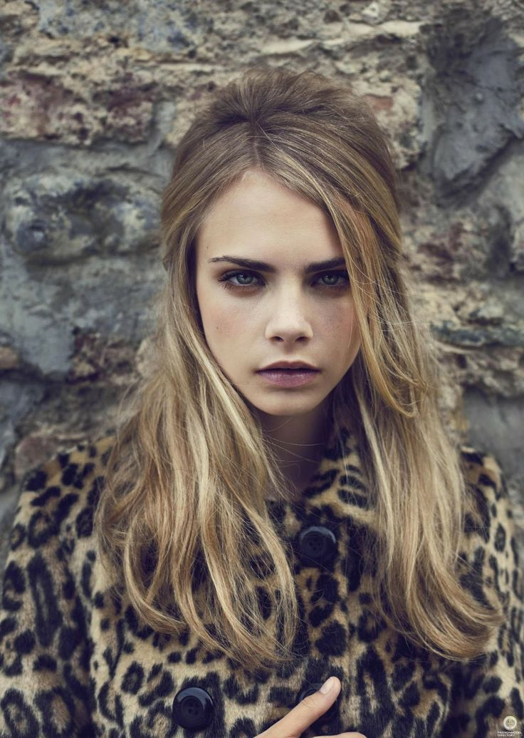 If you focus out, the leopard print merges with the bricks and Cara's beautiful face looks like a wall mount.