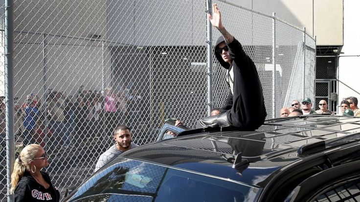 Justin Bieber Exits Jail on DUI Charge, Climbs On Car, Blows Kiss