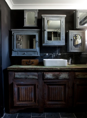 Cool bathroom, it has a lot of wooden medicine cabinets, which I think is whimsical and stylish at the same time. <>